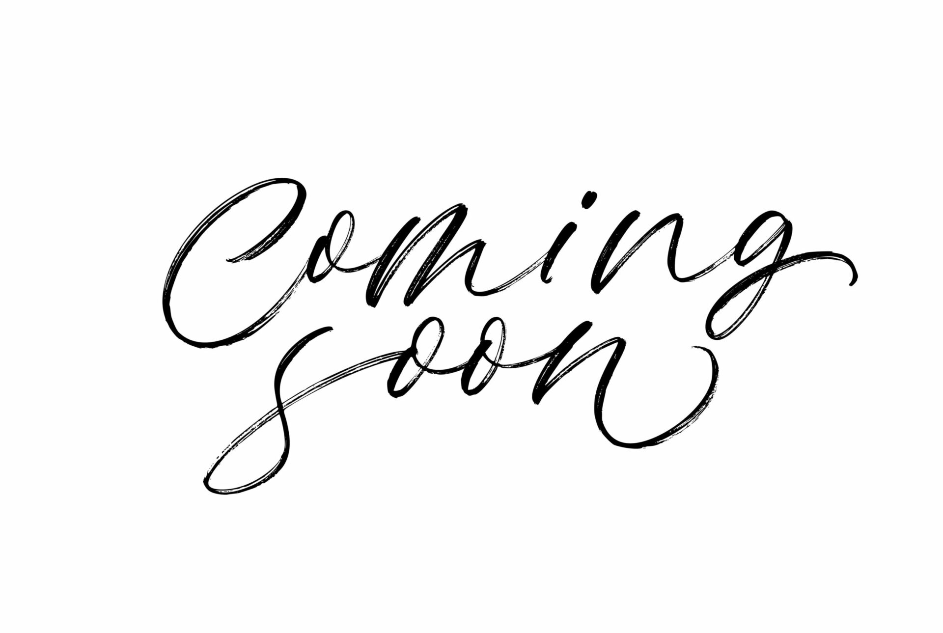 Coming soon phrase handwritten with a calligraphic brush. Ink illustration. Modern brush calligraphy. Isolated on white background.